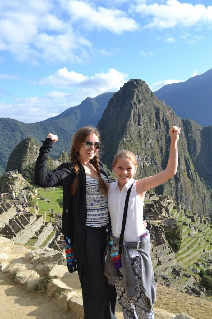 Annie and Molly celebrate arrival to Machu Picchu, Peru