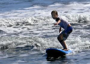 nathan learning to surf tahiti