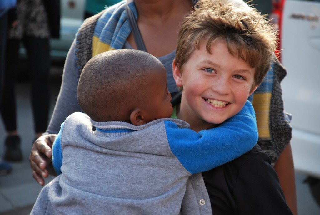 Seamus with child in Soweto on his first Re:Help Organization project