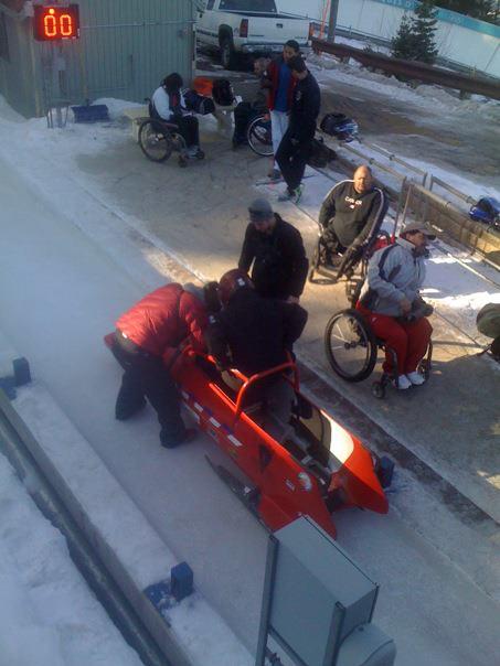 Paralympic hopefuls on bobsled track, Olympic Park, Park City, Utah
