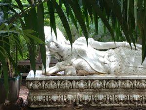 Buddha statue, gardens at Kabiki Hotel, Phnom Penh, Cambodia
