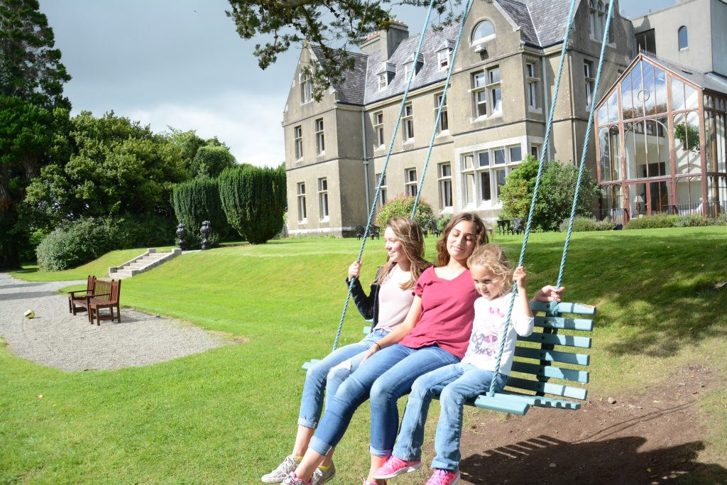 Annie, Caroline and Lela enjoy swinging at a country manor near Killarney, Ireland
