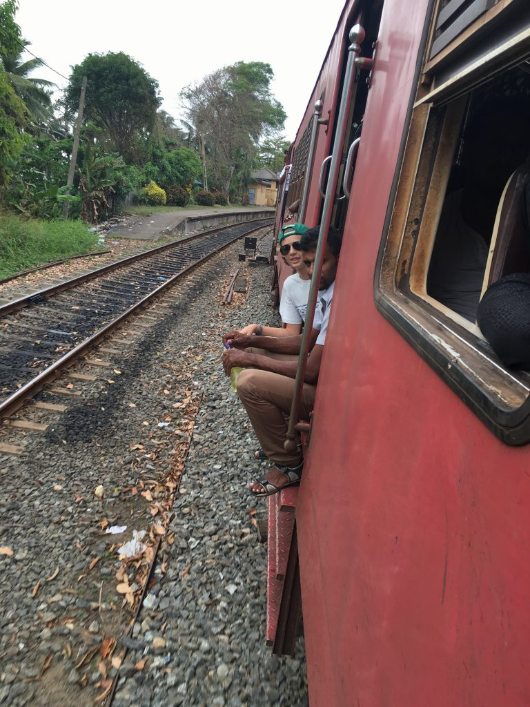 Nathan riding train from Colombo to Galle in Sri Lanka