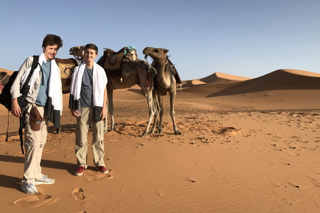 Nathan and Seamus on camel trek on our family vacation in Morocco